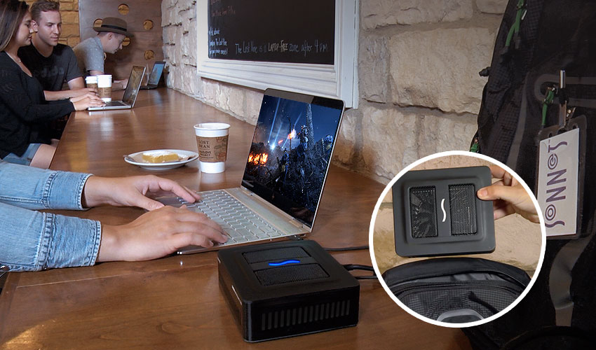 Gamer in Coffe Shop Gaming with Notebook and the eGFX Breakway Puck